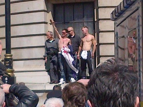 An EDL supporter in London today shows his respect to drummer Lee Rigby